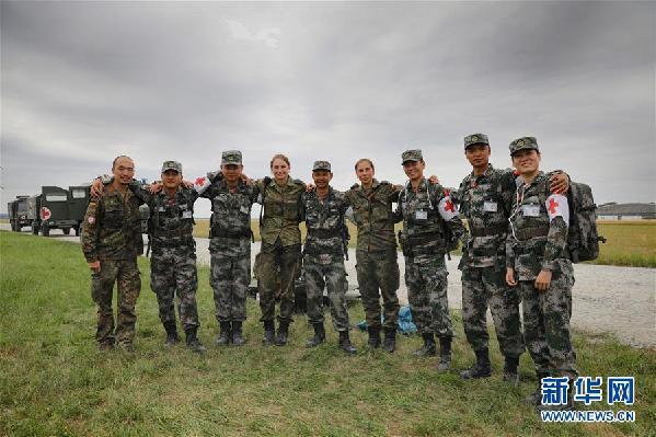 (国际·图文互动)(1)通讯:海外演训场,走来一群中国卫生士官