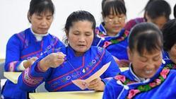 (社會)(2)廣西羅成:學刺繡 促致富